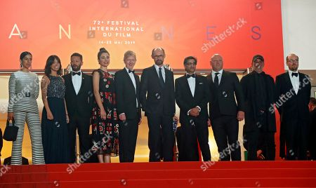 Asif Kapadia (4-R) arrives with film editor Chris King (5-L) and British producer James Gay-Rees (6-L) and guests for the screening of 'Diego Maradona' during the 72nd annual Cannes Film Festival, in Cannes, France, 19 May 2019. The movie is presented out of competition at the festival which runs from 14 to 25 May.
