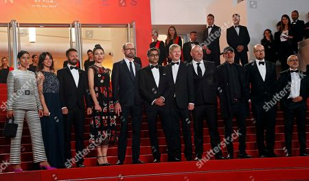 Asif Kapadia (C) arrives with film editor Chris King (5-R) and British producer James Gay-Rees (5-L) and guests for the screening of 'Diego Maradona' during the 72nd annual Cannes Film Festival, in Cannes, France, 19 May 2019. The movie is presented out of competition at the festival which runs from 14 to 25 May.