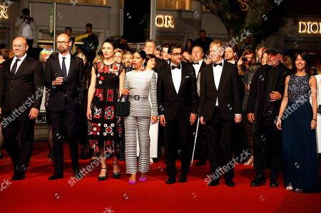 Asif Kapadia (C) arrives with film editor Chris King (3-R) and British producer James Gay-Rees (2-L) for the screening of 'Diego Maradona' during the 72nd annual Cannes Film Festival, in Cannes, France, 19 May 2019. The movie is presented out of competition at the festival which runs from 14 to 25 May.