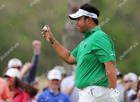 Kiradech Aphibarnrat of Thailand reacts after sinking a chip out of the rough for a birdie on the ninth hole during the final round of the PGA Championship golf tournament, at Bethpage Black in Farmingdale, N.Y
