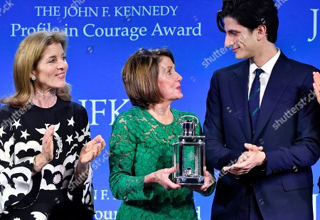 Speaker of the House Nancy Pelosi, D-Calif., center, stands with Caroline Kennedy, and Jack Schlossberg, as she receives the 2019 John F. Kennedy Profile in Courage Award, at the John F. Kennedy Presidential Library and Museum in Boston