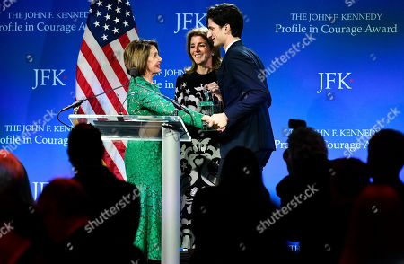 From left, Speaker of the House Nancy Pelosi, D-Calif., center, joins Caroline Kennedy, and Jack Schlossberg, at the podium to receive the 2019 John F. Kennedy Profile in Courage Award, at the John F. Kennedy Presidential Library and Museum in Boston