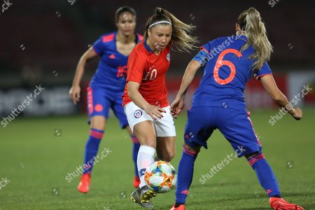 Yanara Aedo (L) of Chile in action against Daniela Montoya (R) of Colombia during the 2019 Women's International Friendly soccer match between the national female soccer teams of Chile and Colombia, at the Nacional Stadium in Santiago, Chile, 19 May 2019.