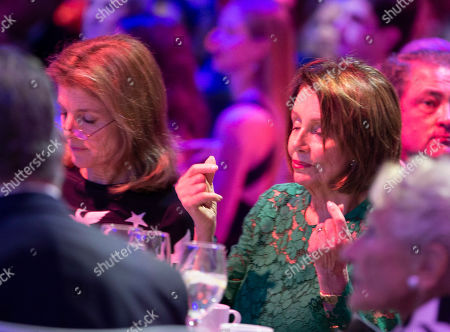 Speaker of the United States House of Representatives Nancy Pelosi (R) gestures while seated next to former US ambassador to Japan Caroline Kennedy (L) before accepting the John F. Kennedy Profile in Courage Award at the John F. Kennedy Library and Museum in Boston, Massachusetts, USA, 19 May 2019. Pelosi was honored for putting the Nation's interest above her party's interest to expand health care for all Americans, and then leading the effort to retake the majority and elect the most diverse Congress in the nation's history.
