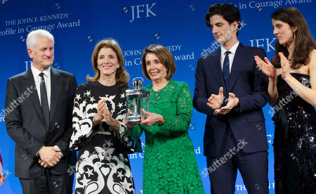 Stock Image of Speaker of the United States House of Representatives Nancy Pelosi (C) accepts the John F. Kennedy Profile in Courage Award from former US ambassador to Japan Caroline Kennedy (2-L), Kennedy's husband Ed (L) her son Jack Schlossberg (2-R) and daughter Tatiana Schlossberg (R) at the John F. Kennedy Library and Museum in Boston, Massachusetts, USA, 19 May 2019. Pelosi was honored for putting the Nation's interest above her party's interest to expand health care for all Americans, and then leading the effort to retake the majority and elect the most diverse Congress in the nation's history.