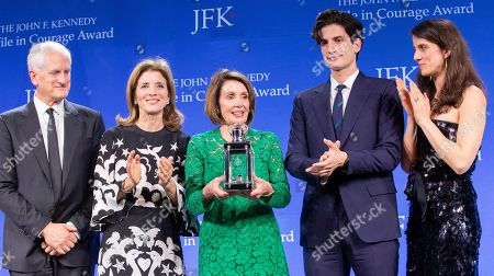 Stock Photo of Speaker of the United States House of Representatives Nancy Pelosi (C) accepts the John F. Kennedy Profile in Courage Award from former US ambassador to Japan Caroline Kennedy (2-L), Kennedy's husband Ed (L) her son Jack Schlossberg (2-R) and daughter Tatiana Schlossberg (R) at the John F. Kennedy Library and Museum in Boston, Massachusetts, USA, 19 May 2019. Pelosi was honored for putting the Nation's interest above her party's interest to expand health care for all Americans, and then leading the effort to retake the majority and elect the most diverse Congress in the nation's history.