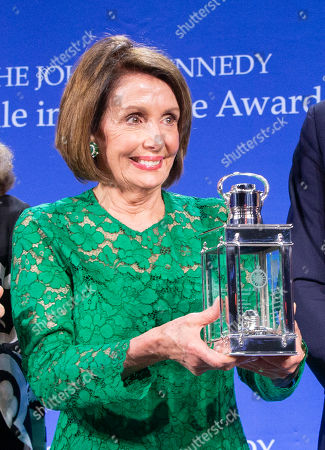 Speaker of the United States House of Representatives Nancy Pelosi holds the John F. Kennedy Profile in Courage Award after receiving it from former US ambassador to Japan Caroline Kennedy (not pictured) at the John F. Kennedy Library and Museum in Boston, Massachusetts, USA, 19 May 2019. Pelosi was honored for putting the Nation's interest above her party's interest to expand health care for all Americans, and then leading the effort to retake the majority and elect the most diverse Congress in the nation's history.