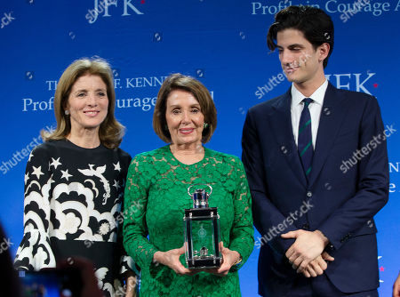 Stock Picture of Speaker of the United States House of Representatives Nancy Pelosi (C) accepts the John F. Kennedy Profile in Courage Award from former US ambassador to Japan Caroline Kennedy (L) and her son Jack Schlossberg (R) at the John F. Kennedy Library and Museum in Boston, Massachusetts, USA, 19 May 2019. Pelosi was honored for putting the Nation's interest above her party's interest to expand health care for all Americans, and then leading the effort to retake the majority and elect the most diverse Congress in the nation's history.
