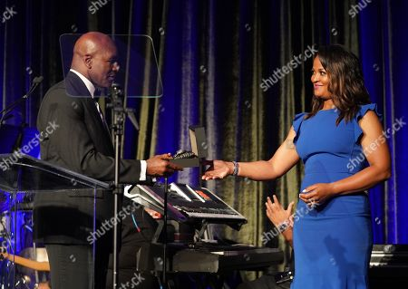 Laila Ali presents award to Evander Holyfield on stage