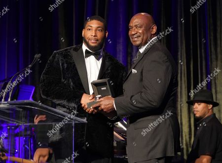 Stock Photo of George Martin presents award to Devon Still