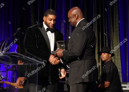 George Martin presents award to Devon Still on stage