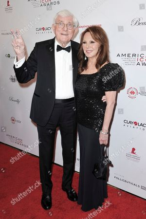 Phil Donahue, Marlo Thomas. Phil Donahue, left, and Marlo Thomas attend the 2019 American Icon Awards at the Beverly Wilshire Hotel, in Beverly Hills, Calif