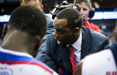 Jay Williams, Head Coach of London City Royals talks to his team during the 3rd Quarter break