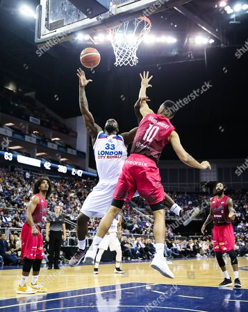 Stock Picture of SamToluwase of London City Royals goes up for a layup with Josh Ward Hibbert of Leicester Riders defending