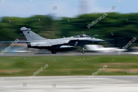 Rafale-type French Navy fighter takes off from Sultan Iskandar Muda Military Base at Aceh Besar, Indonesia, 20 May 2019. A total of seven French Navy Rafale-type fighters made an emergency landing at Sultan Iskandar Muda Military Base, Aceh Besar, Indonesia on 18 May 2019, due to bad weather. The emergency landing was carried out at the Aceh Besar base after the French fighters were taking part in an air exercise with French aircraft carrier Charles de Gaulle, which was reportedly covered in bad weather.