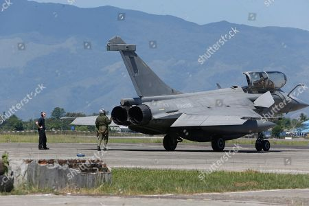 Rafale-type French Navy fighter Pilot make a final check up to his aircraft taking off from Sultan Iskandar Muda Military Base at Aceh Besar, Indonesia, 20 May 2019. A total of seven French Navy Rafale-type fighters made an emergency landing at Sultan Iskandar Muda Military Base, Aceh Besar, Indonesia on 18 May 2019, due to bad weather. The emergency landing was carried out at the Aceh Besar base after the French fighters were taking part in an air exercise with French aircraft carrier Charles de Gaulle, which was reportedly covered in bad weather.