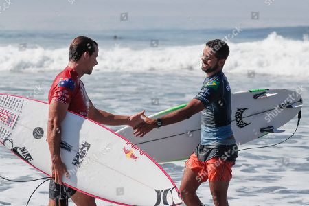 Michael Rodrigues of Brazil (R) shakes hand with Australian Julian Wilson (L) after the Round of 32 at the Corona Bali Protected Surfing event as part of the 2019 World Surf League in Keramas, Bali, Indonesia, 20 May 2019.