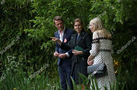 Princess Beatrice with her friend Alice Naylor-Leyland speak with garden designer Andrew Duff in the Savills David Harbour Garden during their visit to the RHS Chelsea Flower Show