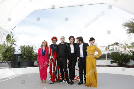 Brazilian actress Flavia Gusmao, Brazilian actress Barbara Santos, Brazilian director Karim Ainouz, Brazilian actor Gregorio Duvivier and Brazilian actress Julia Stockler pose during the photocall for 'A Vida Invisivel de Euridice Gusmao' (The invisible life of Euridice Gusmao) at the 72nd annual Cannes Film Festival, in Cannes, France, 20 May 2019. The movie is presented in the section Un Certain Regard of the festival which runs from 14 to 25 May.