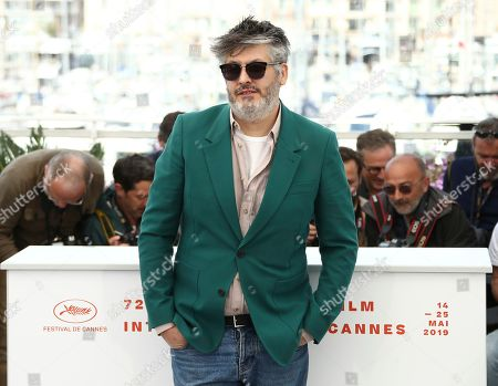 Christophe Honore poses for photographers at the photo call for the film 'Room 212' at the 72nd international film festival, Cannes, southern France