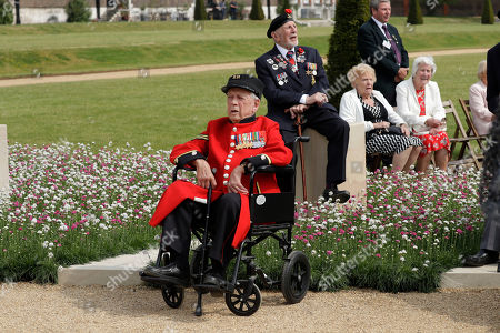 Stock Picture of World War II Normandy veterans sing along to music of their era being sung live by the 'D-Day Darlings' group as they pose for the media on the 'D-Day 75 Garden', for the 75th anniversary of D-Day at the RHS (Royal Horticultural Society) Chelsea Flower Show, backdropped by the Royal Hospital Chelsea in London, . World-renowned and quintessentially British, the annual show is a celebration of horticultural excellence and innovation
