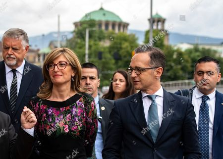 Bulgarian Foreign Minister Ekaterina Zaharieva (L) and German Foreign Minister Heiko Maas (R) during their walk in the center of Sofia, Bulgaria, 20 May 2019. German Foreign Minister Heiko Maas arrived on a two days official visit in Bulgaria.