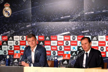 Real Madrid's German midfielder Toni Kroos (L) and the club's Institutional Relations Director, Emilio Butragueno, address a press conference in Madrid, Spain, 20 May 2019. Kroos reported about the renewal of his contract with Real Madrid until 2023.