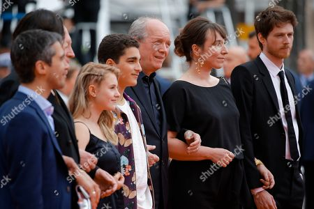 Belgian actor Othmane Moumen, Belgian actress Victoria Bluck, Belgian actor Idir Ben Addi, Belgian director Luc Dardenne, Belgian actress Claire Bodson and French actor Olivier Bonnaud arrive for the screening of 'Le Jeune Ahmed' (Young Ahmed) during the 72nd annual Cannes Film Festival, in Cannes, France, 20 May 2019. The movie is presented in the Official Competition of the festival which runs from 14 to 25 May.