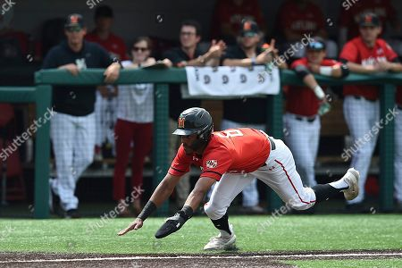 Stock Picture of Maryland's AJ Lee dives for home during an NCAA baseball game on in Baltimore