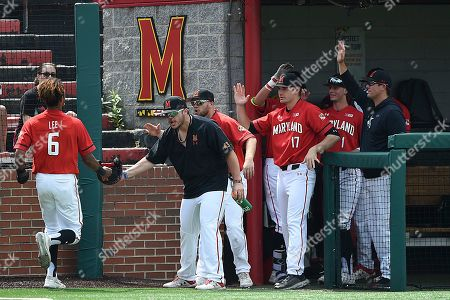 Maryland's AJ Lee celebrates with team mates during an NCAA baseball game on in Baltimore
