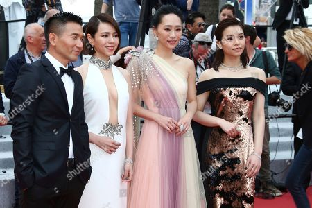 Midi Z, Vivian Sung Yun-hua, Wu Ke-xi, Kimi Hsia Yu-chiao. Film director Midi Z, from left, actresses Vivian Sung Yun-hua, Wu Ke-xi, and Kimi Hsia Yu-chiao pose for photographers upon arrival at the premiere of the film 'Young Ahmed' at the 72nd international film festival, Cannes, southern France