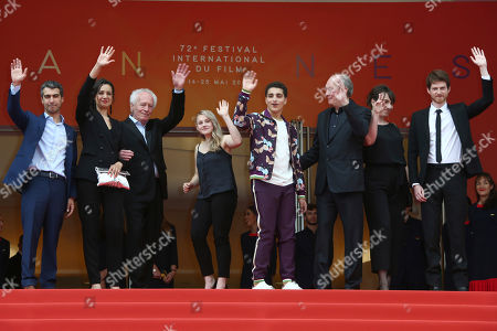 Othmane Moumen, Myriem Akheddiou, Jean-Pierre Dardenne, Victoria Bluck, Idir Ben Addi, Luc Dardenne, Carol Duarte, Olivier Bonnaud. Actors Othmane Moumen, from left, Myriem Akheddiou, director Jean-Pierre Dardenne, actors Victoria Bluck, Idir Ben Addi, director Luc Dardenne, actors Carol Duarte and Olivier Bonnaud pose for photographers upon arrival at the premiere of the film 'Young Ahmed' at the 72nd international film festival, Cannes, southern France