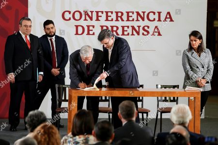 Mexican President Andres Manuel Lopez Obrador (C-L) signs the decree that will eliminate taxes exemption for big companies during his daily morning press conference at the National Palace, in Mexico City, Mexico, 20 May 2019. The Mexican Government exempted big companies from paying 20.9 billion dollars in taxes between 2007 and 2018, during the terms of Felipe Calderon and Enrique Pena Nieto.
