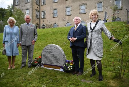 Britain's Prince Charles, Prince of Wales (2-L), Camilla, Duchess of Cornwall (L), Ireland's President, Michael D. Higgins (2-R) and his wife Sabina Coyne unveil a plaque while visiting the Glencree Centre for Peace and Reconciliation in Glencree, Ireland, 20 May 2019. The Prince of Wales and the Duchess of Cornwall visit the Republic of Ireland from 20 to 21 May 2019. This will be Their Royal Highnesses' fifth annual visit to Ireland since 2015.