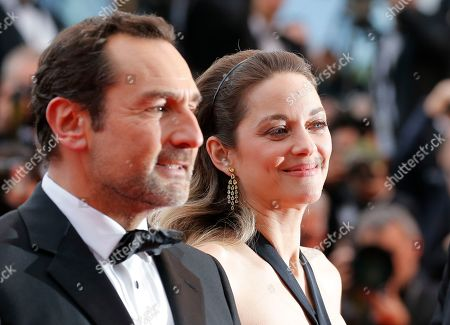 Gilles Lellouche (L) and French actress Marion Cotillard arrive for the screening of 'La Belle Epoque' during the 72nd annual Cannes Film Festival, in Cannes, France, 20 May 2019. The movie is presented out of competition at the festival which runs from 14 to 25 May.