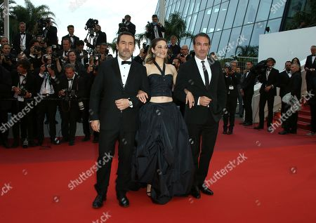 Marion Cotillard, Jean Dujardin. Actors Gilles Lellouche, from left, Marion Cotillard and Jean Dujardin pose for photographers upon arrival at the premiere of the film 'La Belle Epoque' at the 72nd international film festival, Cannes, southern France