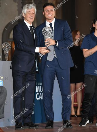 Argentinian former soccer player Javier Zanetti (R) with Italian former soccer player Gianni Rivera attend the ''Hall of Fame of Italian soccer'' award ceremony in Florence, Italy, 20 May 2019.