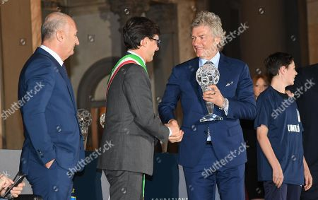 Italian former soccer player Giancarlo Antognoni (R) with Florence's Mayor Dario Nardella attend the ''Hall of Fame of Italian soccer'' award ceremony in Florence, Italy, 20 May 2019.