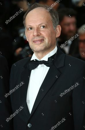 Denis Podalydes poses for photographers upon arrival at the premiere of the film 'La Belle Epoque' at the 72nd international film festival, Cannes, southern France