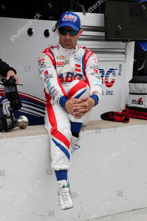 Tony Kanaan, of Brazil, sits in his team's pit area before the start of practice for the Indianapolis 500 IndyCar auto race at Indianapolis Motor Speedway, in Indianapolis