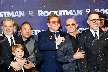 Director Dexter Fletcher, actor Stephen Graham, musician Elton John, songwriter Bernie Taupin and producer David Furnish, from left to right, pose at the UK Film Premiere of Rocketman at the Odeon Luxe in London