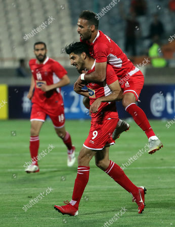 Stock Photo of Perspoli Mehdi Torabi (C) celebrates with his team mate Ahmad Nourollahi (TOP) after scoring during the AFC Champions League group D soccer match between Perspolis FC and Al-Sadd SC at the Azadi Stadium in Tehran, Iran, 20 May 2019.