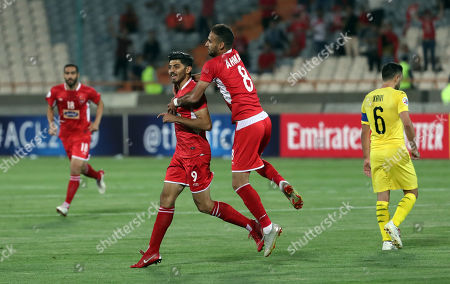 Perspoli Mehdi Torabi (l) celebrates with his team mate Ahmad Nourollahi (R) after scoring during the AFC Champions League group D soccer match between Perspolis FC and Al-Sadd SC at the Azadi Stadium in Tehran, Iran, 20 May 2019.