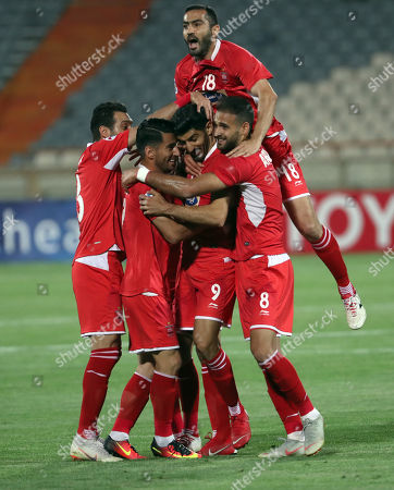 Perspoli Mehdi Torabi (C) celebrates with his team mates after scoring during the AFC Champions League group D soccer match between Perspolis FC and Al-Sadd SC at the Azadi Stadium in Tehran, Iran, 20 May 2019.