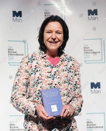 Translator of Polish literature Antonia Lloyd-Jones poses with Olga Tokarczuk's novel 'Drive Your Plow Over the Bones of the Dead' during a photocall for The Man Booker International Prize 2019 in London, Britain, 20 May 2019. The winner of the Man Booker International Prize 2019 will be announced in London 21 May.