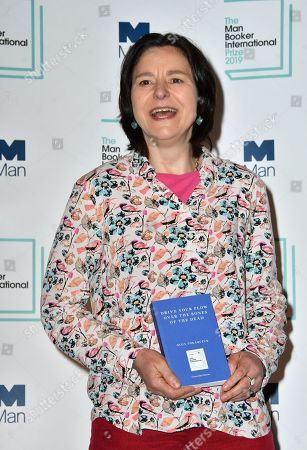 Stock Photo of Antonia Lloyd-Jones with the book she translated Drive Your Plow Over The Bones Of The Dead