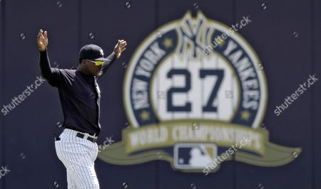 New York Yankees' Didi Gregorius stretches before a Gulf Coast League baseball game, in Tampa, Fla. Gregorius is playing for the first time since having Tommy John surgery