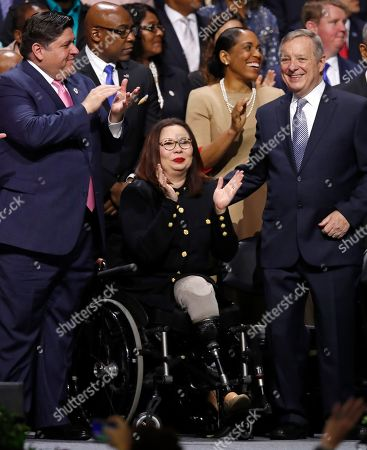 J.B. Pritzker, Tammy Duckworth, Dick Durbin. Governor of Illinois J.B. Pritzker, left, and U.S. Senators Tammy Duckworth, center, and Dick Durbin during an inauguration ceremony, in Chicago
