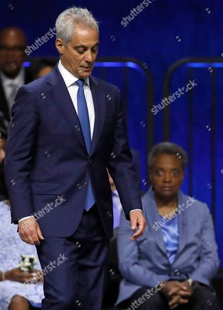 Outgoing Mayor Rahm Emanuel, left, walks past incoming Mayor Lori Lightfoot, during her inauguration ceremony, in Chicago