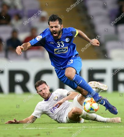 Bengt Erik Berg (L) of Al Ain FC in action against Pejman Montazeri of Esteghlal F.C. during the AFC Champions League group C soccer match between Al Ain FC and Esteghlal Tehran F.C. in Al Ain, United Arab Emirates, 20 May 2019.